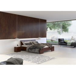 Vyššia masívna posteľ z borovice SALERNO morenie orech
