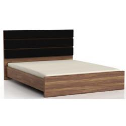 Dvojlôžková posteľ s čalúneným čelom